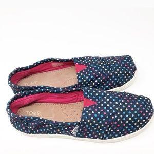 Toms polka-dot shoes.